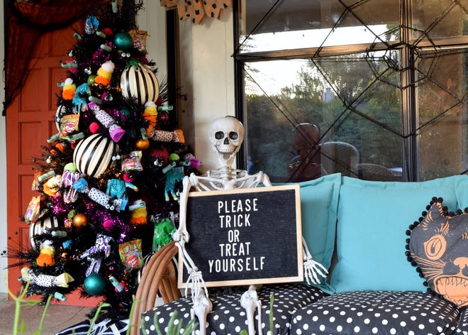 Create a Halloween tree with accompanying props for your front porch.
