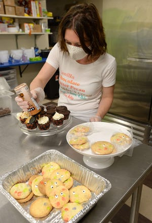 Allyson Minor, 36, co-owner of Serendipity Sweets, in Erie, makes gluten-free desserts.