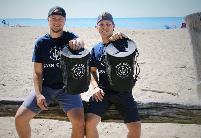 Tyler Waltenbaugh, left, and Hunter Klobucar will launch sales of their Clean Earth Bag, a reusable bag made for outdoor enthusiasts to pick up, contain and recycle plastic and garbage they encounter, on Kickstarter on Tuesday. The two men are the founders and operators of Fish Gods LLC.