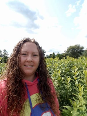 Hornell's Heather Sills stands in a milkweed field in the Canisteo Valley.