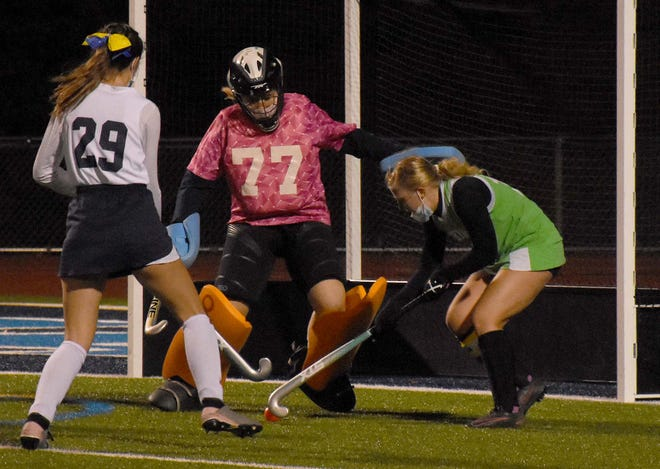 Central Valley Academy goalie Morgan Russo (77) stands her ground against Herkimer Magician Molly McDonnell (right) during overtime play in Monday's game at the Diss Memorial Sports Complex.