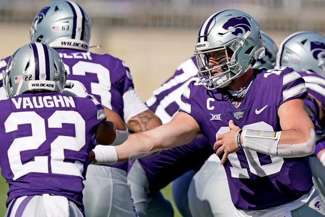 Kansas State quarterback Skylar Thompson (10) hands the ball to running back Deuce Vaughn (22) during the Oc.t 3 game against Texas Tech.  Thompson, a Fort Osage High School graduate, will miss the rest of season after undergoing surgery on the shoulder of his throwing arm.