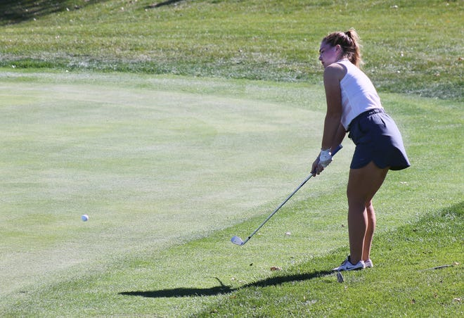 Truman's Katelyn Bragg chips onto the green from the fringe in the Class 3 District 4 Tournament Monday at Shiloh Springs Golf Course in Platte City. Bragg, who shot 95, and Molly Bradshaw, who carded a 106, became the first Truman girls golfers to make it the state tournament since 2011.