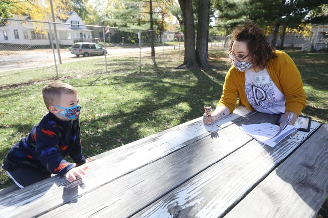 Wendy Mossman, a preschool teacher at Corse Early Childhood Center, talks with Carter Cushman Tuesday, Oct. 13, after students turned in their worksheets from a scavenger hunt at the Burlington school. The Burlington School District's certified enrollment for the 2020-21 school year is expected to be significantly lower than from last year — by between 150 and 180 students. Making up for a significant portion of the Burlington School District's drop are preschool, which has about 34.5% fewer students than the 190 students typically enrolled, and kindergarten, which typically serves about 260 students but this year is serving only 210 — a drop of about 19%.