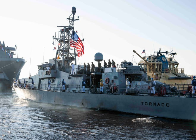 The U.S.S. Tornado arrives Tuesday at its homeport at Naval Station Mayport after helping seize about $50 million in cocaine from drug smugglers.