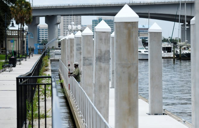 As survey crews took measurements on the new floating dock on the Southbank of the St. Johns River in front of Friendship Fountain on Sept. 3, crews on the Northbank were removing the old floating dock from the riverwalk property where The Jacksonville Landing once stood.