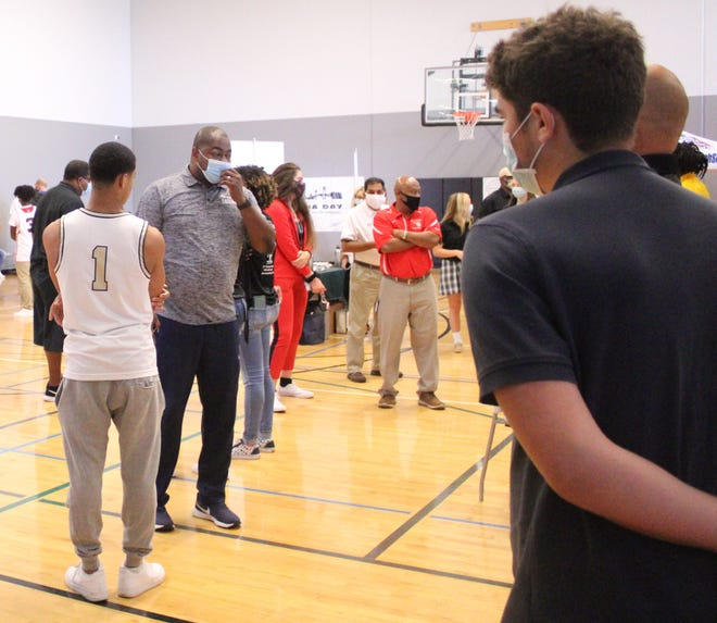 High school players, coaches and reporters gather for High School 9:12 Media Day at the Winston Family YMCA in Jacksonville on Tuesday.