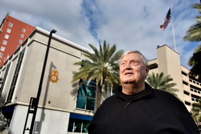 Jacksonville City Council will vote on approving a $250,000 settlement with John Keane, retired executive director of the Police and Fire Pension Fund. In this file photo, Keane stands in front of the downtown Jacksonville owned by the pension fund.