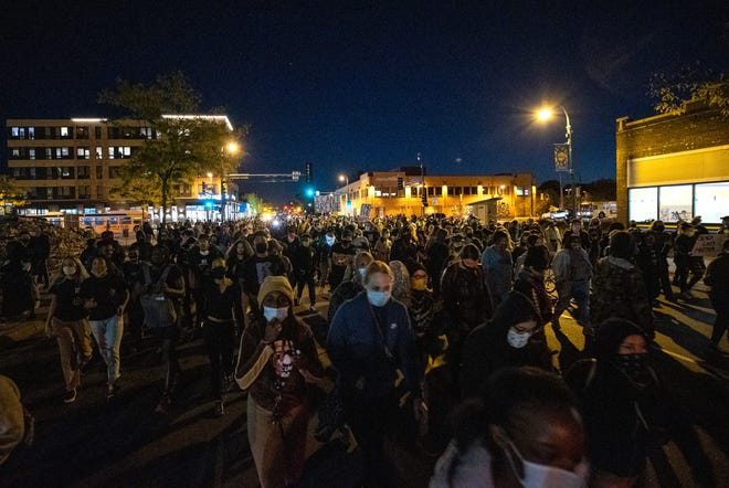 Demonstrators block an intersection in Minneapolis on Oct. 7 after Derek Chauvin, the former Minneapolis police officer charged with murder in the death of George Floyd, posted bail and was released from prison.