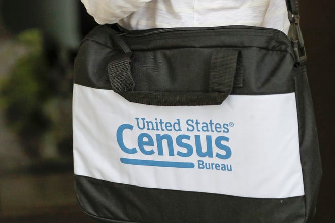 A briefcase of a census taker is seen as she knocks on the door of a residence in August in Winter Park. A half-million census takers headed out en masse that week to knock on the doors of households that hadn't yet responded to the 2020 census.