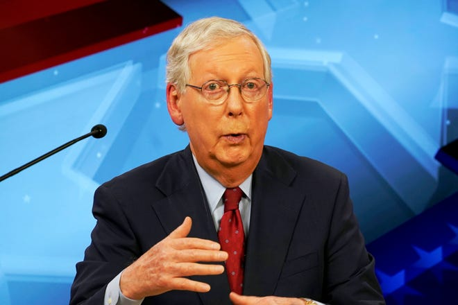 Senate Majority Leader Mitch McConnell, R-Ky., speaks during a debate with Democratic challenger Amy McGrath in Lexington, Ky., on Monday.