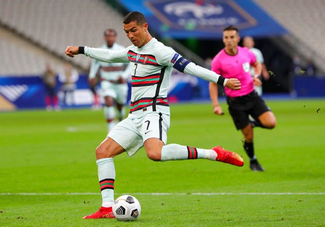 Portugal's Cristiano Ronaldo attempts a shot at goal during the UEFA Nations League soccer match between France and Portugal at the Stade de France in Saint-Denis, north of Paris, France, Sunday, Oct. 11, 2020.