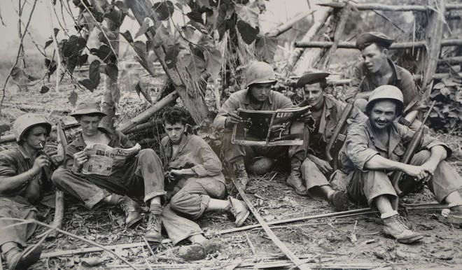 Members of the famed WWII Army unit Merrill's Marauders sit less than 75 yards from enemy positions. The photo was on display during a gathering of remaining members, family and history buffs, in New Orleans. The unit that spent months marching and fighting behind enemy lines in Burma has been approved to receive the Congressional Gold Medal, Congress' highest honor. Nearly 3,000 soldiers began the unit's secret mission in Japanese occupied Burma in 1944. Barely 200 remained in the fight when their mission was completed five months later.