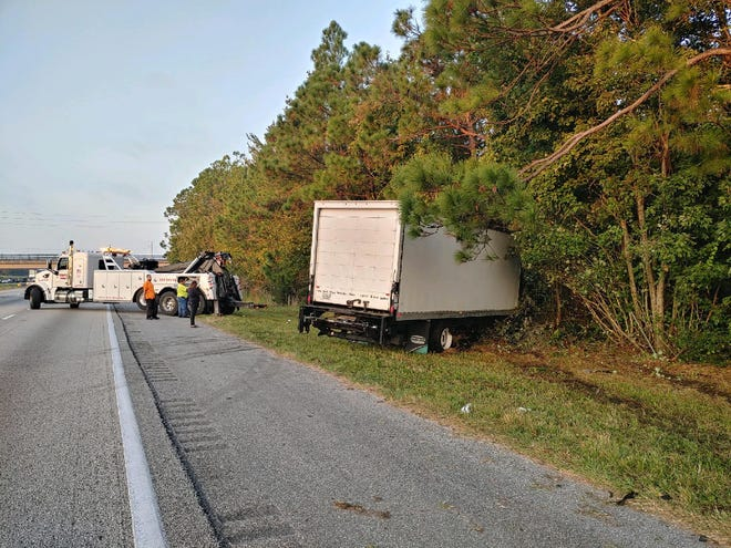 A box truck came to rest on Interstate 4 after it struck an abandoned Jeep SUV on Tuesday morning.