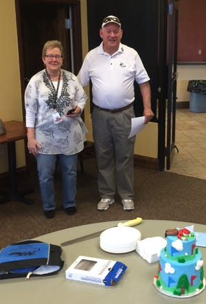 Cleveland Heights head pro Keith Wightman with his wife, Susan. Wightman is retiring at the end of the month.