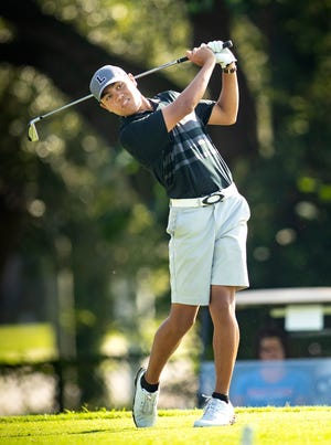 Lakeland's Ron Nicholas watches his tee shot while playing in the Boys 3A District golf tournament at Cleveland Heights Golf Course in Lakeland on Tuesday. Nicholas won with a 2-over-par 74.
