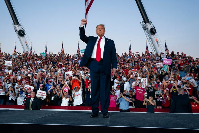 President Donald Trump arrives for a campaign rally at Orlando Sanford International Airport, Monday, Oct. 12, 2020, in Sanford.