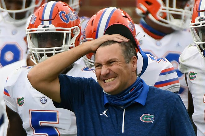 """Florida head coach Dan Mullen reacts during the second half of an NCAA college football game against Mississippi in Oxford, Miss., last month. No. 10 Florida paused all team activities Tuesday following """"an increase in positive COVID tests among players."""""""