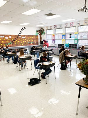 Students sit and work silently in Mrs. Bourke's eighth grade classroom at Sisson School in Mount Shasta.