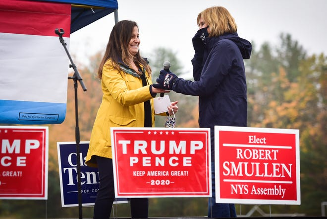 From left, U.S. Rep. Elise Stefanik, R-Schuylerville, hands a microphone to then-congressional candidate Claudia Tenney during a Back the Blue rally at the Dolgeville Athletic Club on Tuesday, Oct. 13, 2020. The congressional representatives participated in a virtual forum Wednesday, hosted by The Genesis Group of the Mohawk Valley Region.