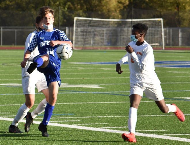 Whitesboro senior Jordan Dutcher (14), deep into Rome Free Academy's end of the pitch, beats Rome Free Academy's Ryan Hanba (back) and Matteo Lubecki (right) to keep the ball in play during a boys soccer game Tuesday at the Ed Wadas Athletic Complex in Marcy.