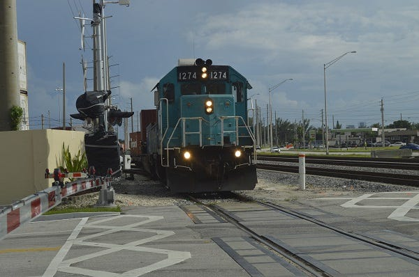 Port of Palm Beach officials say a $13 million infrastructure grant will let the port double the number of train and truck container loads it handles.