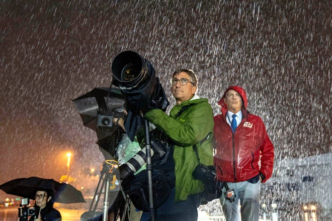 Allen Eyestone awaits the arrival of President Donald Trump in the rain