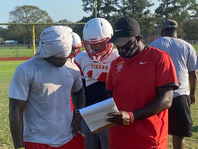 East Iberville Coach Justin Joseph, seen here in practice with his players, hopes to keep the Tigers undefeated when they visit Belaire for non-district action Friday night.