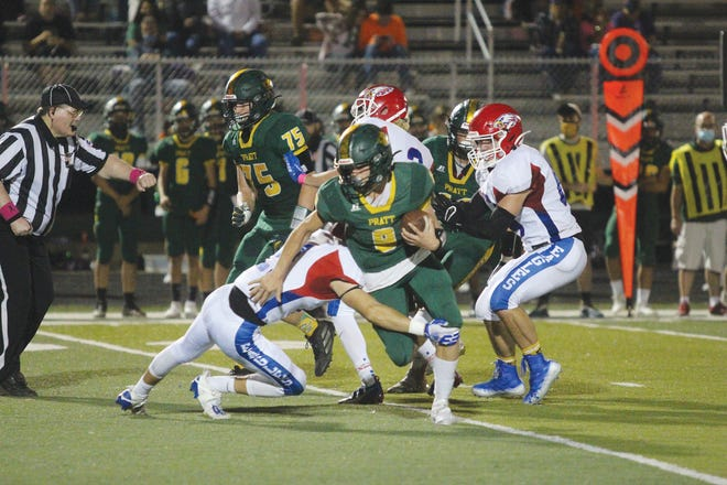 Pratt High School's Devon Weber, #9, scrambles for yardage Friday, October 9, as the Greenbacks fight back against a tough Hugoton team that eventually won the contest 22-16.