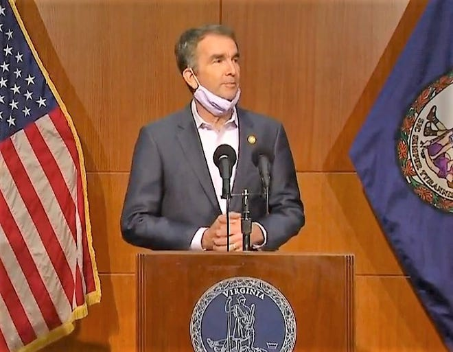 Gov. Ralph S. Northam, D-Virginia, answers a question during a news conference at the Patrick Henry Building in downtown Richmond, Va. Tuesday, Oct. 13, 2020. It was the governor's first day at work following an 18-day quarantine for testing positive for COVID-19.