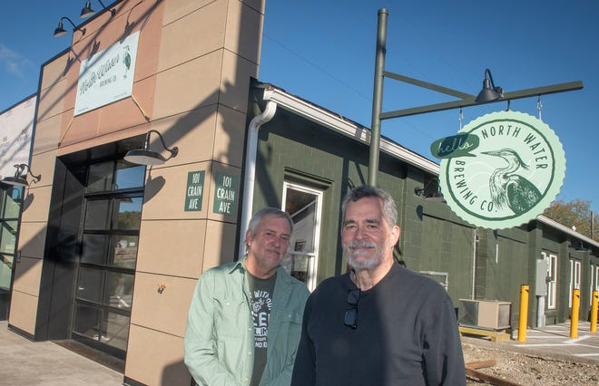 The North Water Brewing Co. includes an outdoor dining area. Co-owner Don Schjeldahl, left, said the business should open in about three weeks if it gets the permits it needs this week. Bob Mayfield, another co-owner, will help plan art and art-centered events at the brewery.