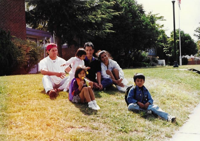 Joel Adrian Iboa as a child, far right, sits in front of Whiteaker Elementary. He's joined by (back row) Jose Vergara, Zulema Iboa, Joel Iboa Sr. and Emerita Iboa. Tami Vergara holds the flower.
