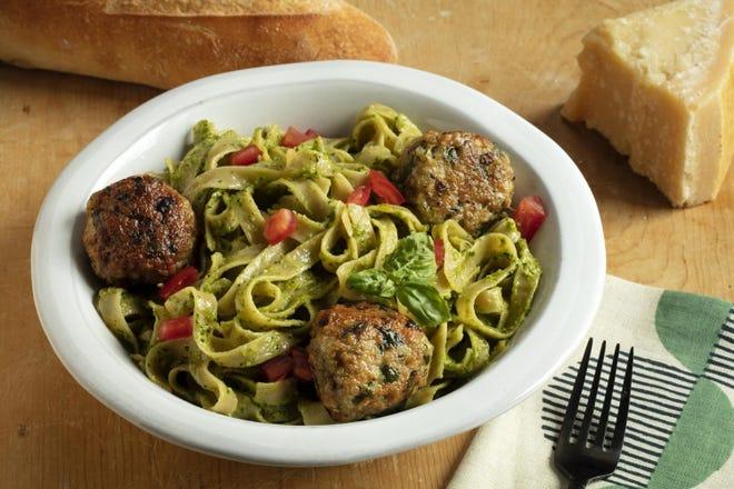 Fettucine with cilantro-almond pesto and chicken meatballs.