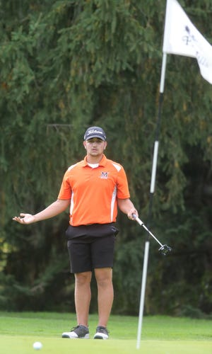 Marlington's Charlie Mort reacts after a putt on No. 1 during Monday's Division I boys golf district tournament at Pine Hills.