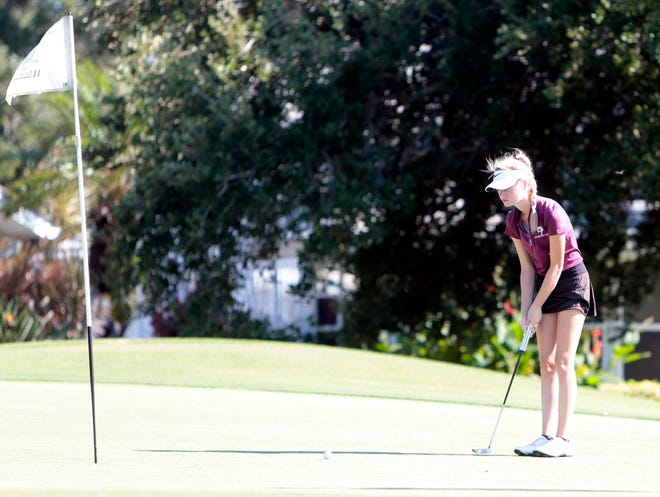 Aaron Whitley of Riverview lines up her putt on the 8th hole on the Turnberry Course at Waterford Golf Club on Monday in Venice. Whitley was the medalist with a 5-under-par 67.