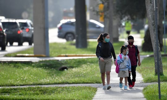 Students walked to Wilkinson Elementary on Monday morning, Aug. 31, 2020 for the first day of school in Sarasota County.