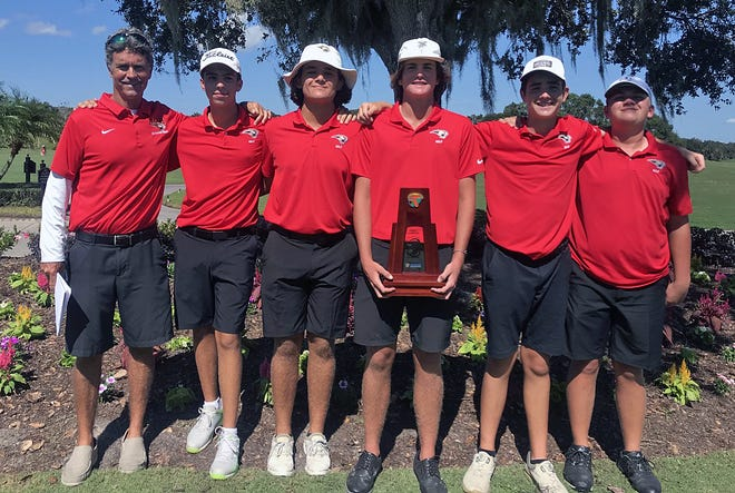 Members of the Cardinal Mooney Catholic boys golf team pose with the first-place trophy after winning the Class 1A-District 10 tournament Monday at Laurel Oak Country Club