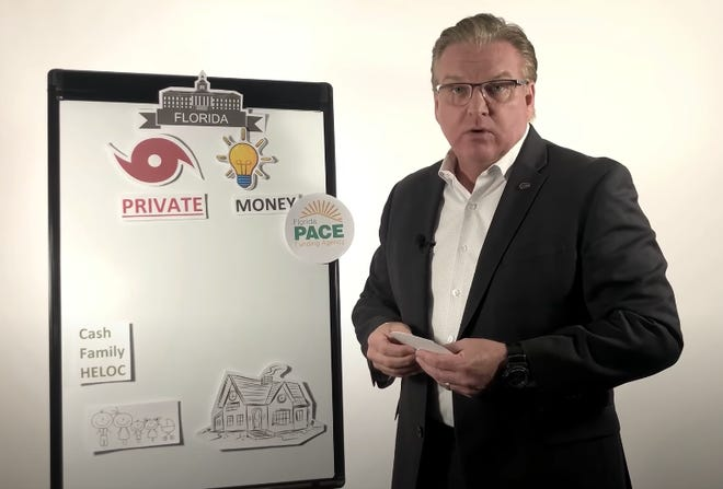Sarasota County Commissioner Michael Moran said he does not believe a conflict of interest exists in his simultaneously serving as a county leader and as a head of Florida PACE Funding Agency. Above, Moran appears in a screen capture from a YouTube video in which he explains how Property Assessed Clean Energy programs work.