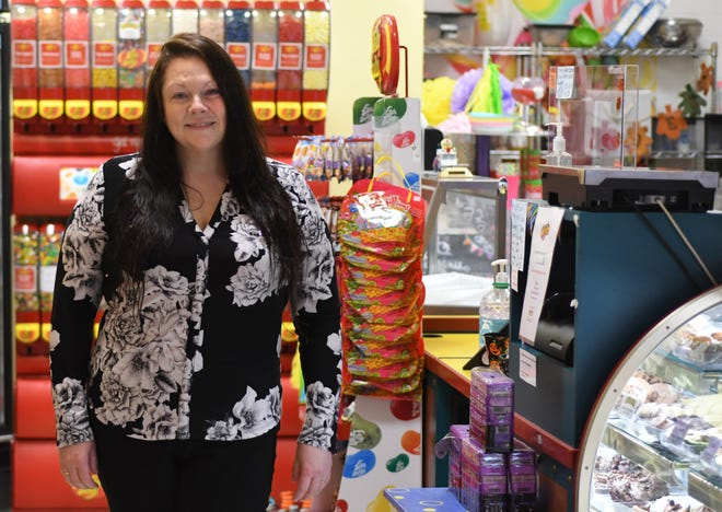 Sarah Taravath, owner of Fuzziwig's Candy Factory, stands inside the store in Mayfaire in Wilmington, N.C., Tuesday, October 13, 2020. Taravath traveled to India in early March and ended up being stuck there for over four months due to travel restrictions from COVID-19.   [MATT BORN/STARNEWS]