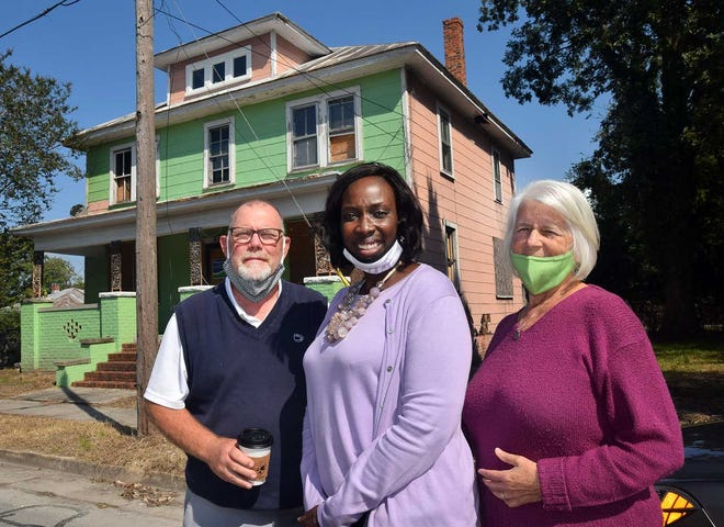 My Sister's House Project Manager Rich Patton, founder and director Bonita Simmons and Volunteer Coordinator Deedra Durocher stand in front of the future transitional home for women's getting out of prison.