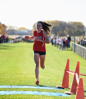Paityn Noe shattered her own school record with a 5-kilometer time of 17:36 to win an individual Raccoon River Conference title for Ballard Monday at the conference meet. Teammate Shewaye Johnson came in second as both runners beat top-ranked Ainsley Erzen of Carlisle. The duo helped Ballard, ranked first in Class 3A, win its sixth RRC title in a row.