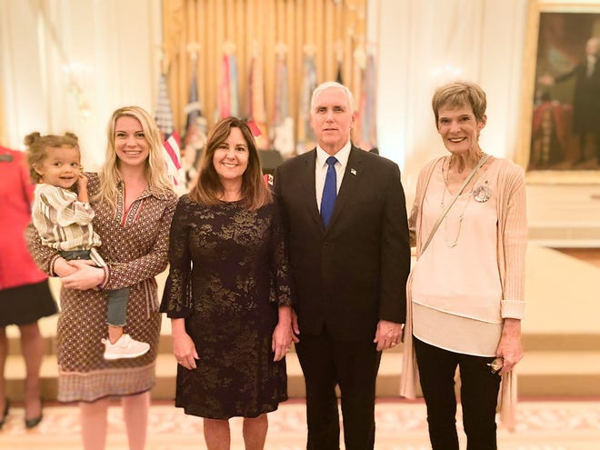 Britt Harris, far left, her daughter, Christian, and mother-in-law, Sue, stand with Vice President Mike Pence and his wife, Karen Pence, during a White House event in September that honored Gold Star families. Harris's husband, Spc. Chris Harris, died in a roadside bombing during his August 2017 deployment to Afghanistan.