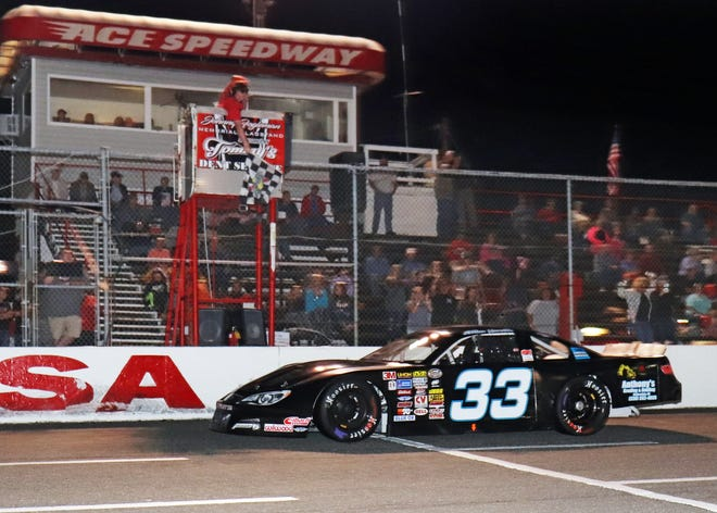 Dillon Harville's No. 33 car crosses the finish line beneath the checkered flag in June 2019 to secure the first Ace Speedway victory of his career.