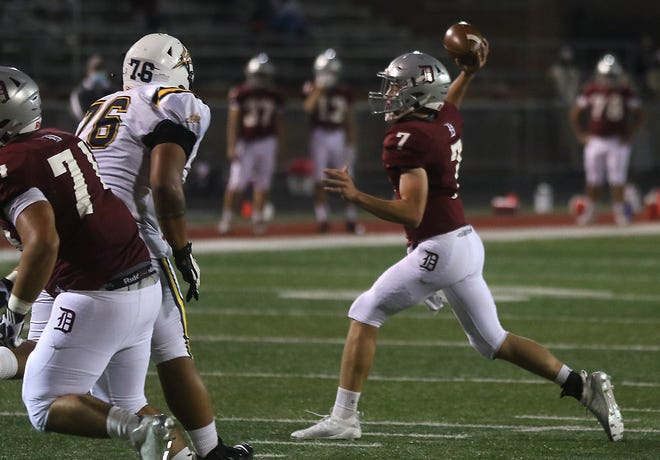 """Dover""""s TC Molk throws a pass in the playoff game with Tallmadge."""