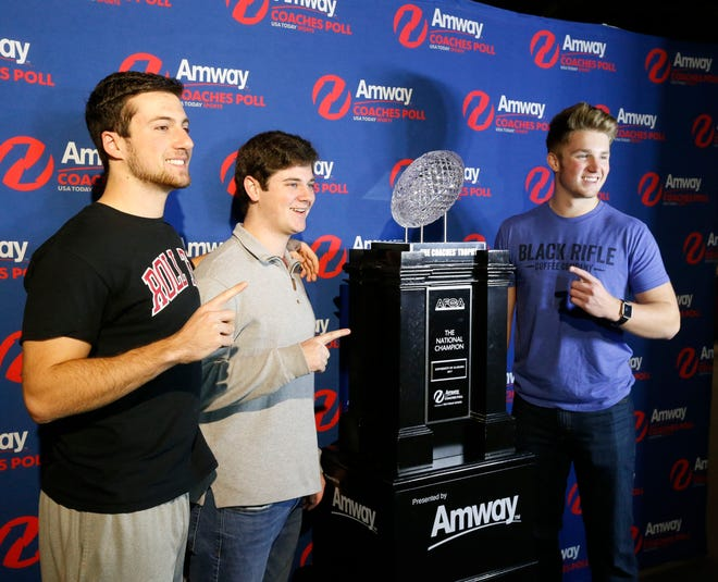 University of Alabama students Jake Sinacori, Zack Aitken and Cooper Allenbrand pose for photos with The Coaches Trophy, the crystal football given to national champions under the BCS series Friday, Jan. 19, 2018 in the Bryant Museum. [Staff Photo/Gary Cosby Jr.]