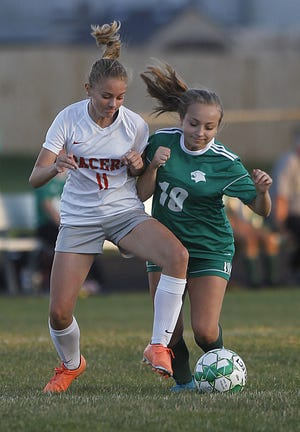 Westland's Reagan Schumacher (right) and Delaware's Moira Lewis battle for possession on Oct. 8. The Cougars open the Division I district tournament with a second-round game Saturday, Oct. 24, at Dublin Coffman.