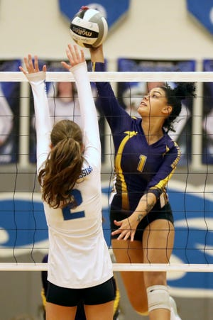 "Senior Jordan Brooks, a 5-foot-11 outside hitter, has helped the Reynoldsburg girls volleyball team enjoy a strong season. ""The reason everything has really come together slowly but surely is because all of our coaches are very good coaches,"" she said."