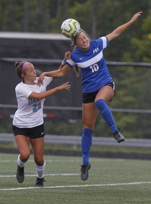 Bradley's Avery Jantonio (right) heads the ball from Darby's Ellie Janetski on Aug. 22. The Jaguars were 4-0-1 after beating Gahanna 1-0 on Sept. 12 but closed the regular season 0-7-1 after returning from a two-week quarantine.