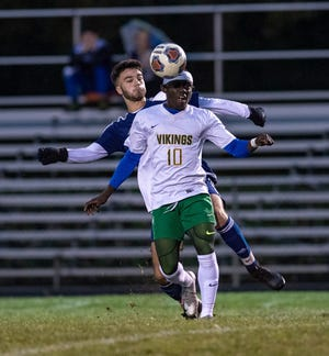 Northland's Roland Ohene Ntow controls the ball in front of Whetstone's Sam Garcia on Sept. 30. The Vikings were 7-0 after beating Walnut Ridge 9-0 on Oct. 8 and outscored their first seven opponents by a combined 30-4.