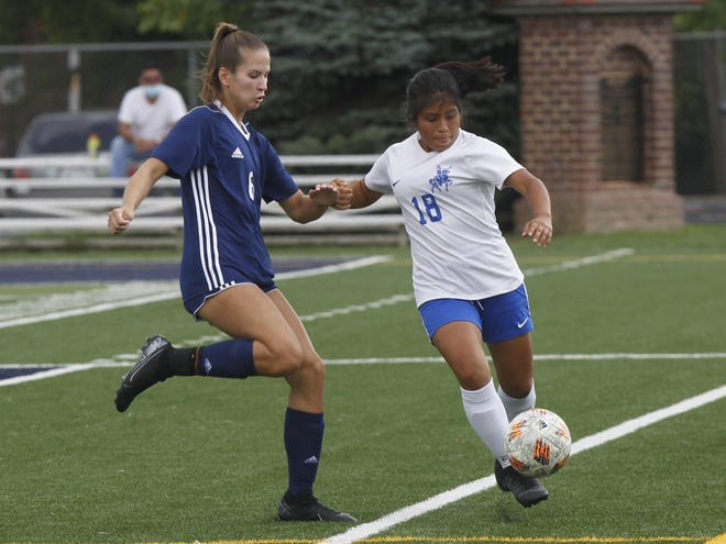 Ready's Jesica Saldana (right) tries to keep the ball from Grandview's Tayler Pierce on Sept. 12. After winning seven games last season, the Silver Knights were 2-8-3 before playing Wellington on Oct. 15 and also endured a midseason coaching change.